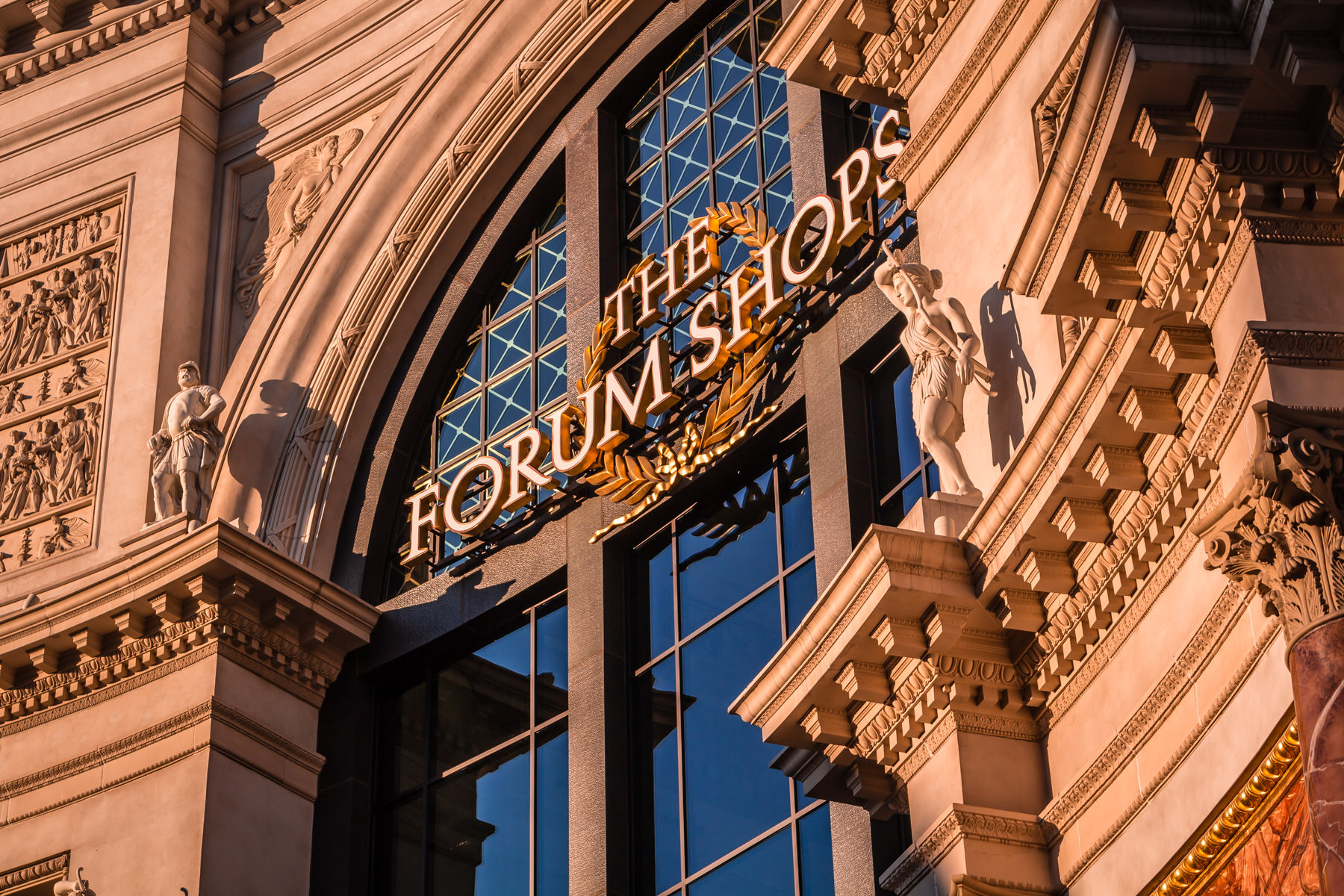 The sign at the main entrance of The Forum Shops at Caesars Palace catches the early-morning Las Vegas sun.