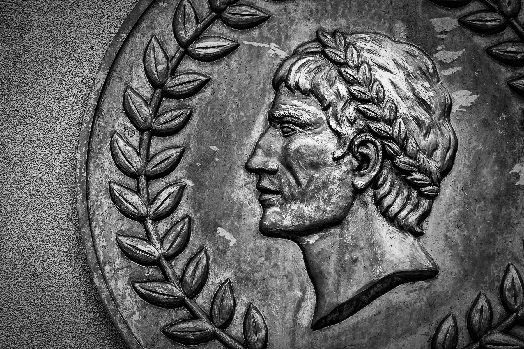 A medallion depicting the profile of Julius Caesar on an exterior wall of Caesars Palace, Las Vegas.