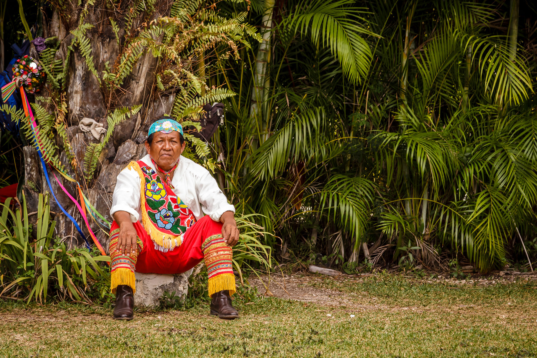 A Mayan dancer rests after performing the traditional Danza de los Voladores (Dance of the Flyers) in San Miguel, Cozumel, Mexico.