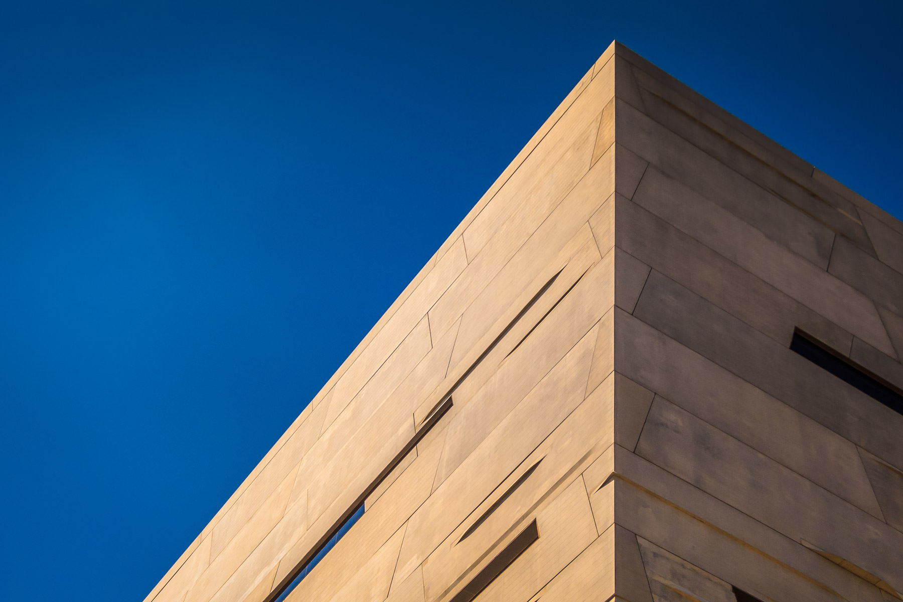 An abstract architectural study of the exterior of Dallas' Perot Museum of Nature & Science.