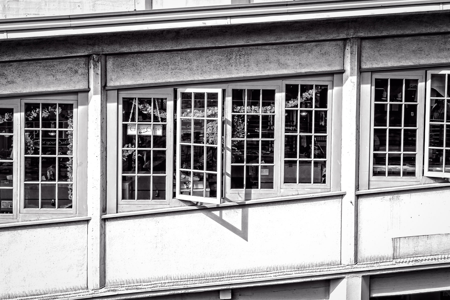 Windows built into a sloped part of a building at Seattle's Pike Place Market.