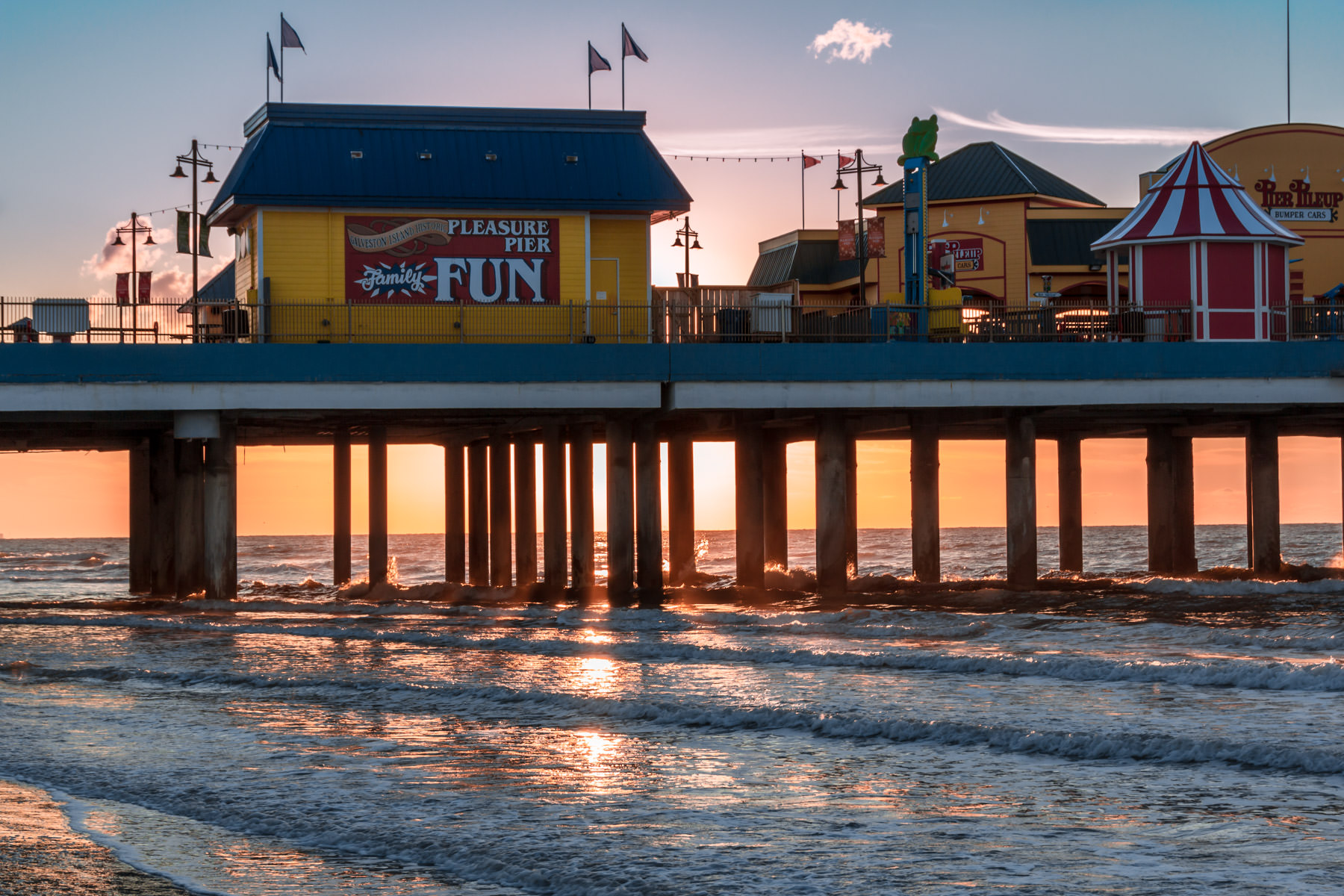 The sun rises over the Gulf of Mexico behind Galveston, Texas' Pleasure Pier.