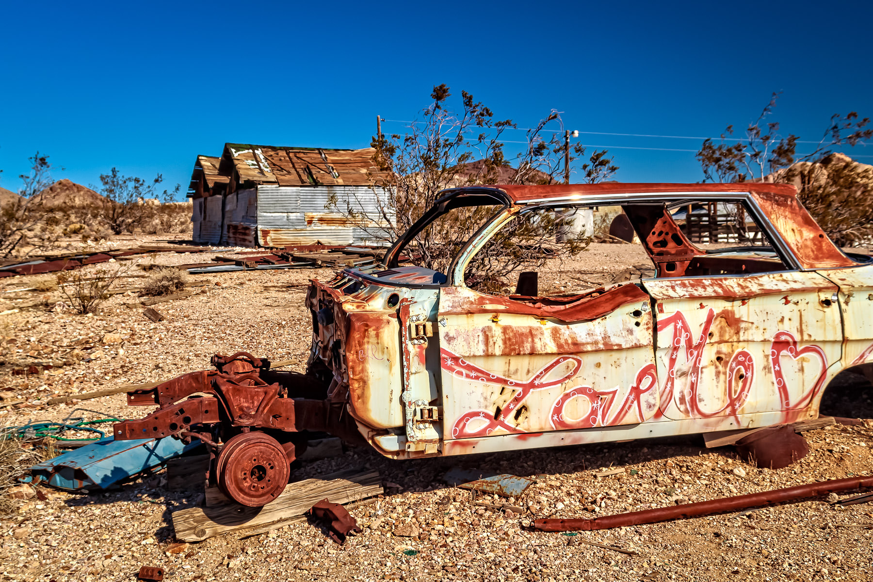 A decidedly un-loved Chevrolet Impala decays in the Nevada desert at the ghost town of Rhyolite.