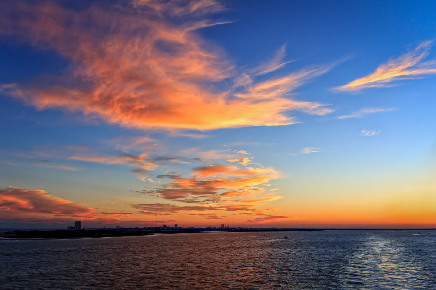Clouds illuminated by the setting sun over Galveston Bay, Texas.