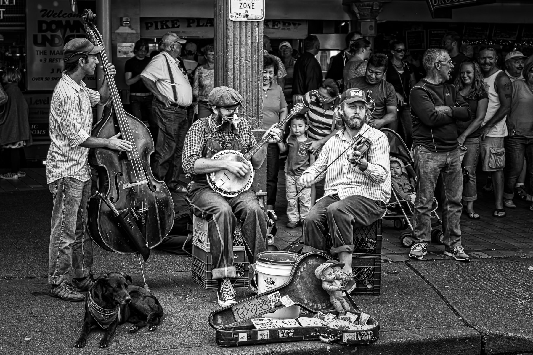 Blues & Jazz trio The Gin Jars busk for tips at Seattle's Pike Place Market.
