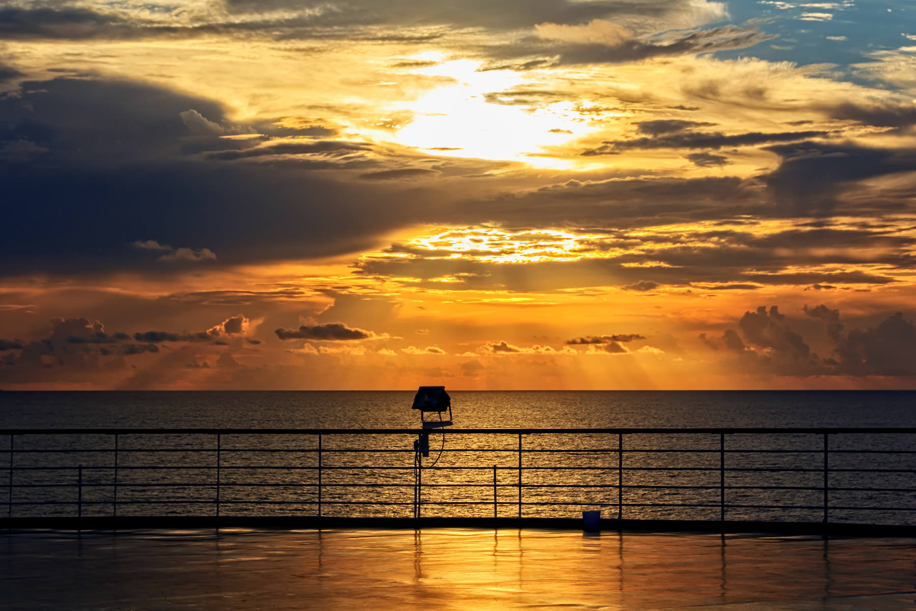 The sun rises over the Gulf of Mexico as seen from the deck of the cruise ship Carnival Triumph.