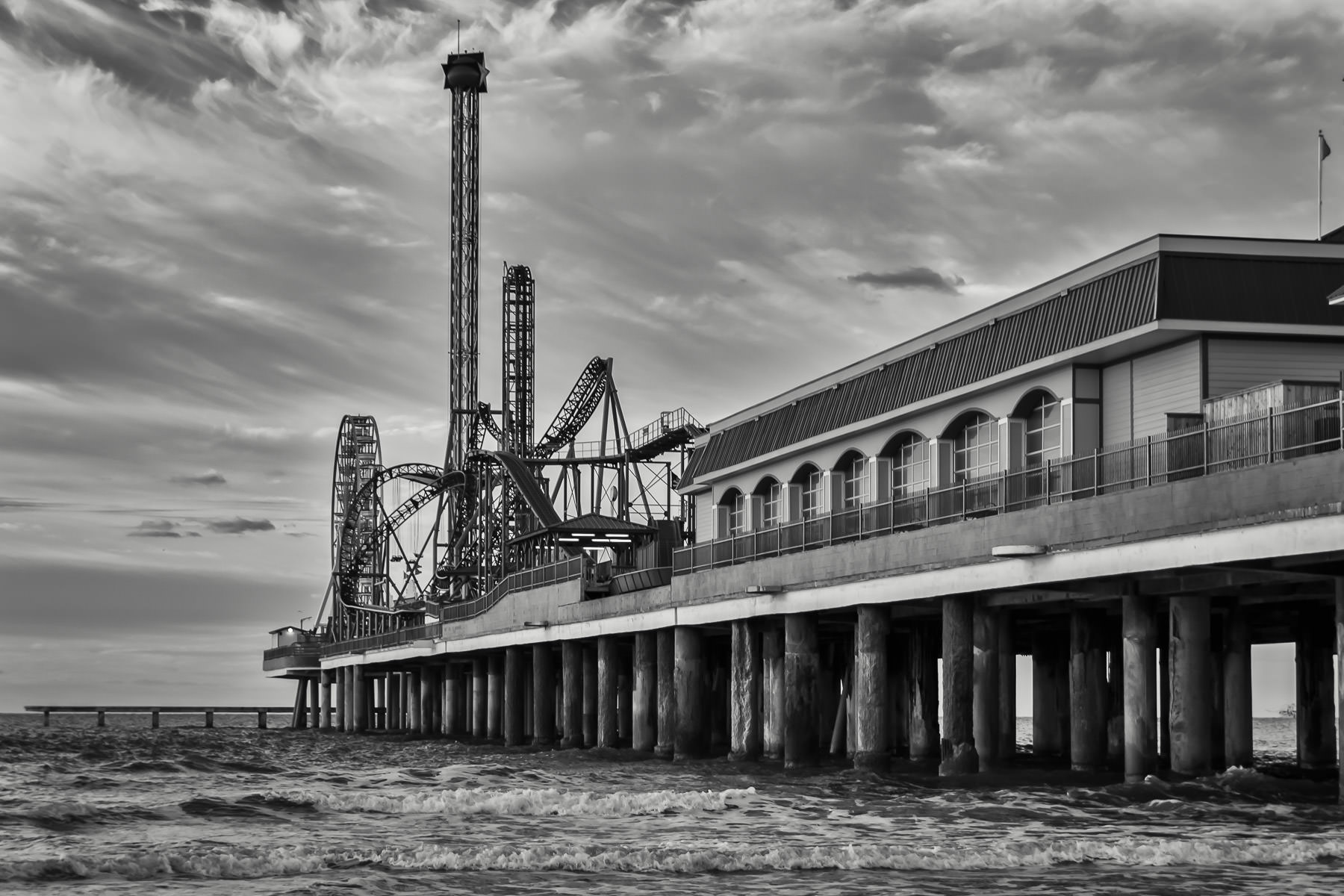 Galveston, Texas' Pleasure Pier rises from the surf of the Gulf of Mexico.