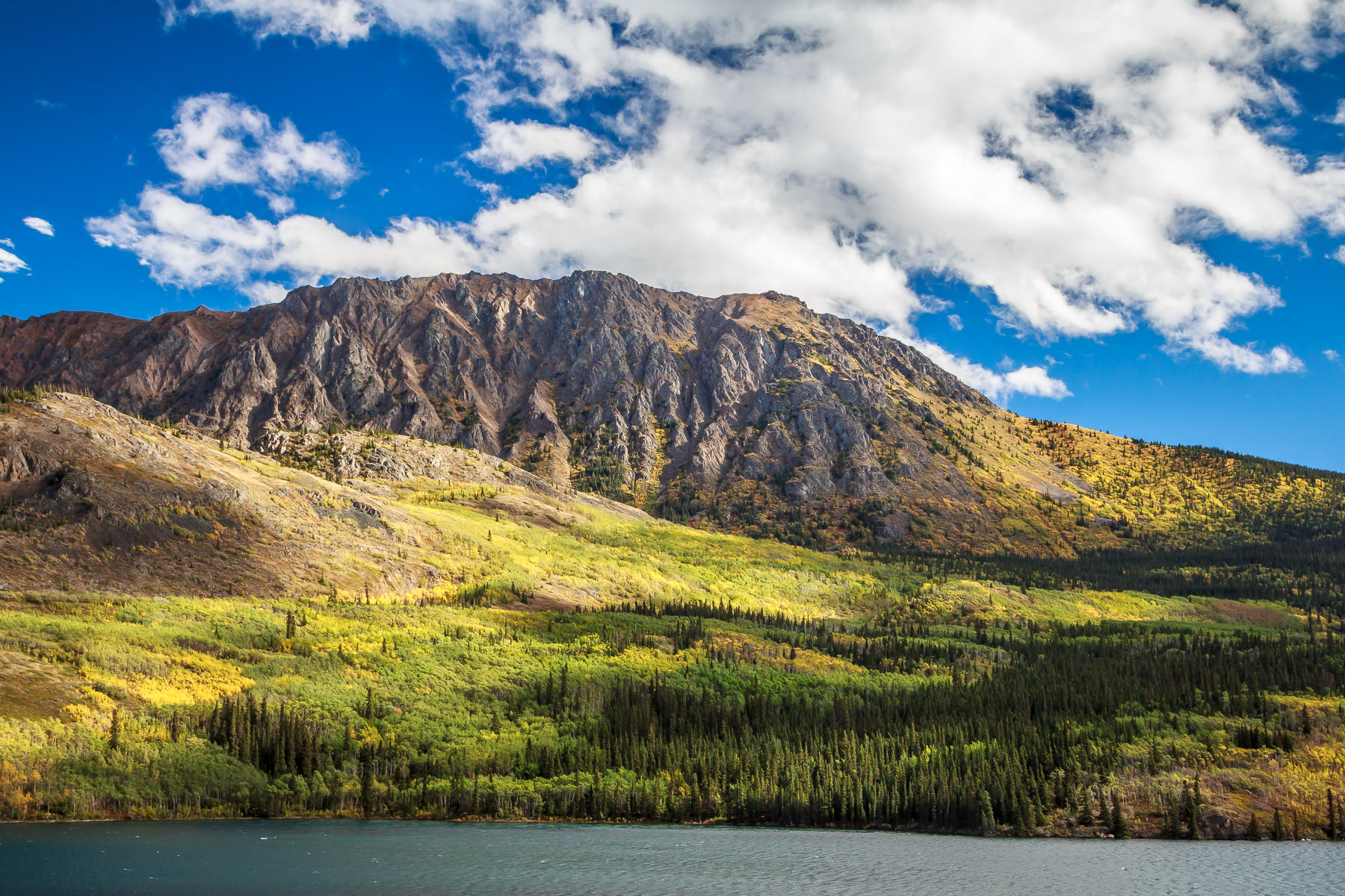 A mountain rises on the far shore of Tagish Lake, British Columbia along the Klondike Highway.