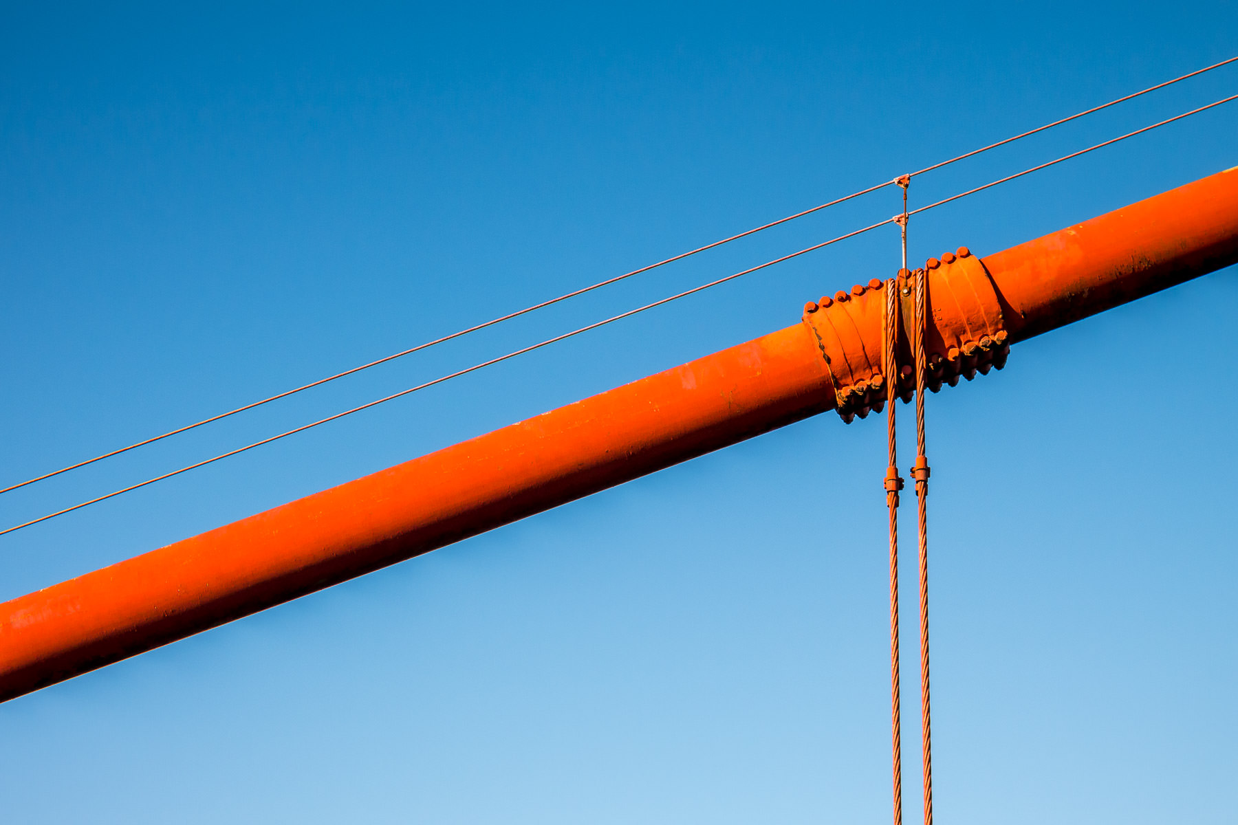 Detail of one of San Francisco's Golden Gate Bridge's main suspension cables. This cable is 36.5-inches-wide (93 cm) and contains 27,572 individual wires.
