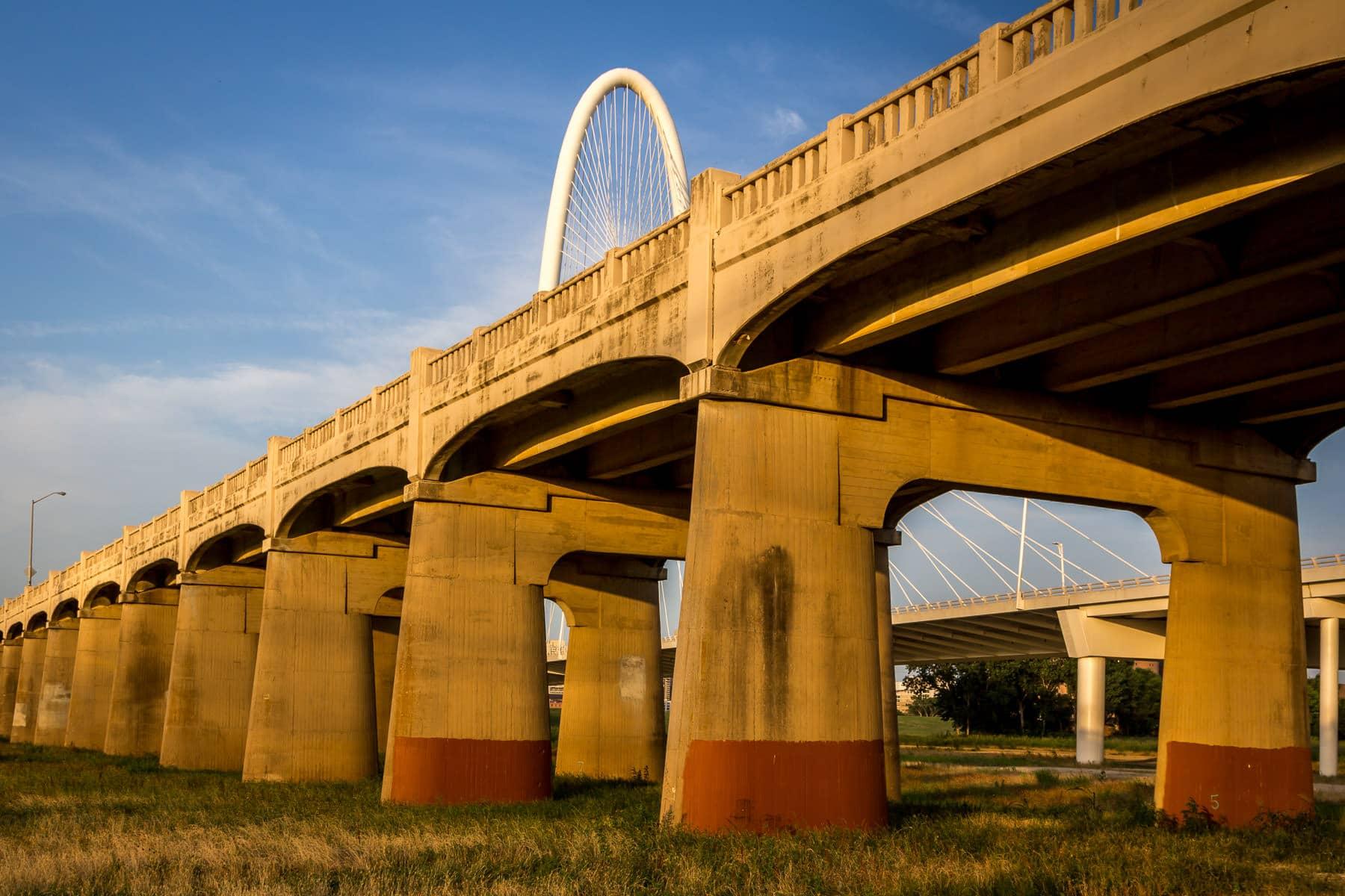 Dallas' Continental Avenue Bridge spans the Trinity River as the Santiago Calatrava-designed Margaret Hunt Hill Bridge looms in the background.