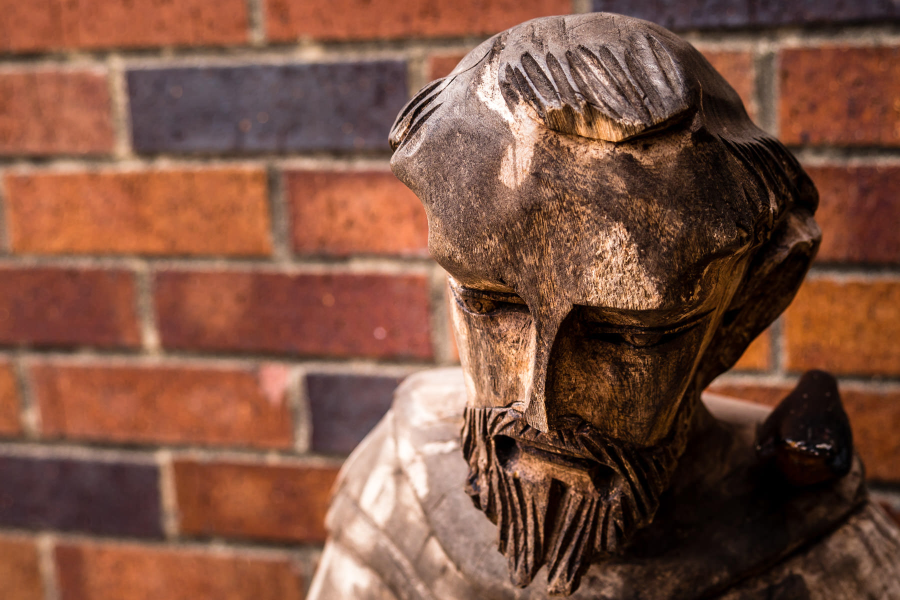 A coarsely-carved statue of Saint Francis of Assisi spotted outside a shop in Downtown Grapevine, Texas.