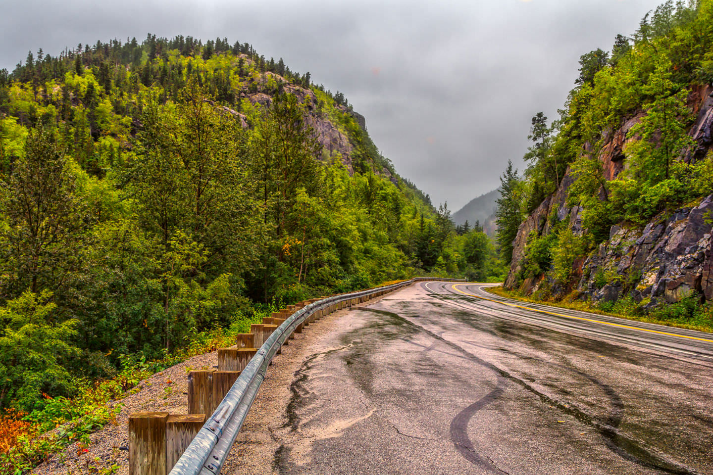 The Klondike Highway cuts between two mountaintops northeast of Skagway, Alaska near the British Columbia border. Incidentally, if you're ever planning on visiting Skagway and want to rent a car and drive into the Yukon, I can't recommend Murray's Guide enough.