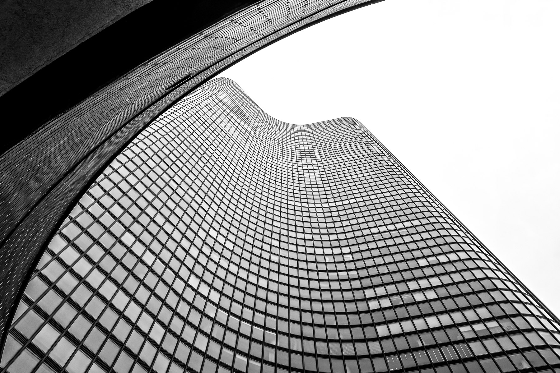 The graceful curves of Chicago's Lake Point Tower rise into the overcast sky.