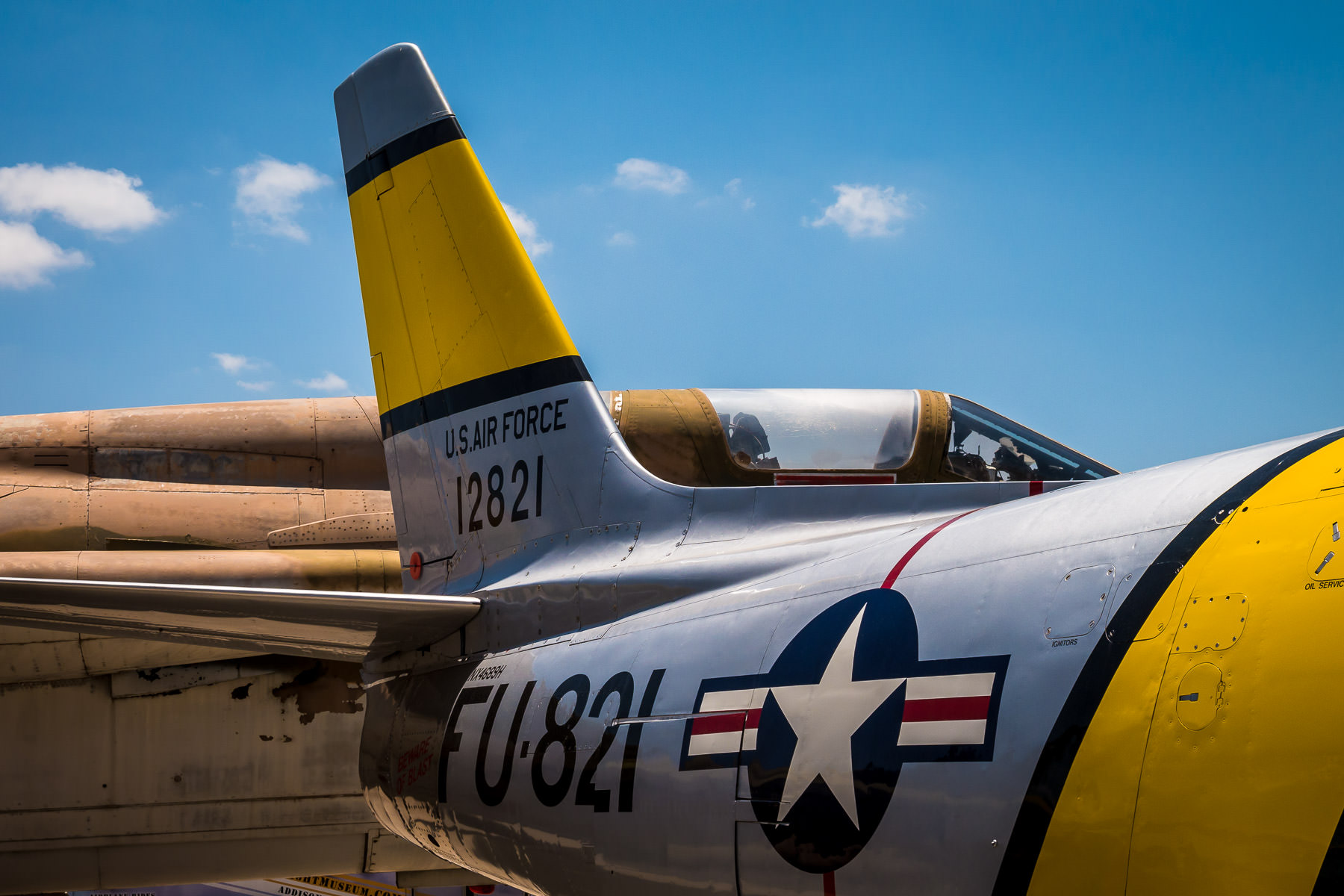A North American F-86 Sabre (foreground) and a Republic F-105 Thunderchief at Addison, Texas' Cavanaugh Flight Museum.
