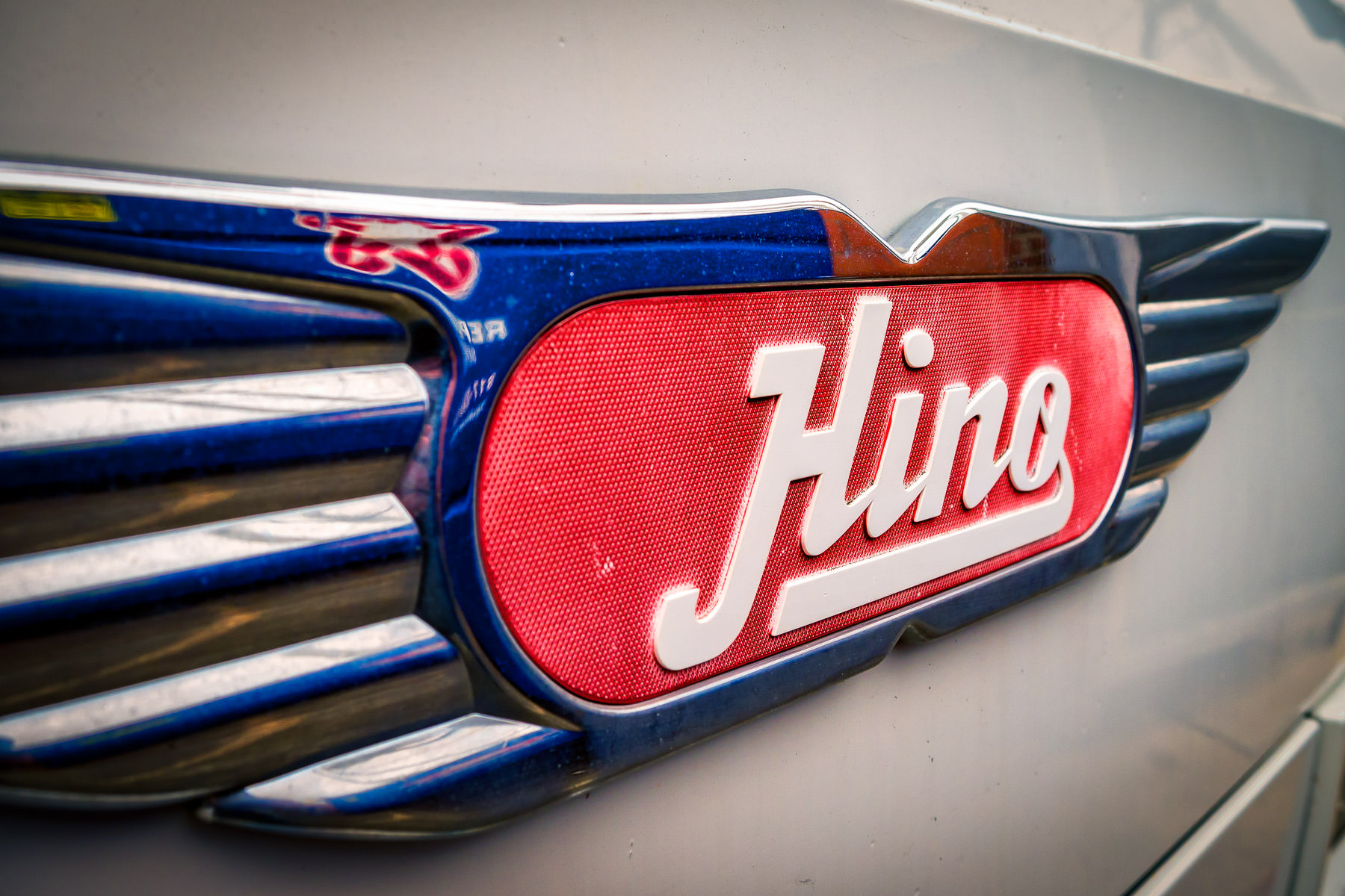Detail of the manufacturer's nameplate on a Toyota Hino medium-duty truck spotted in Downtown Grapevine, Texas.