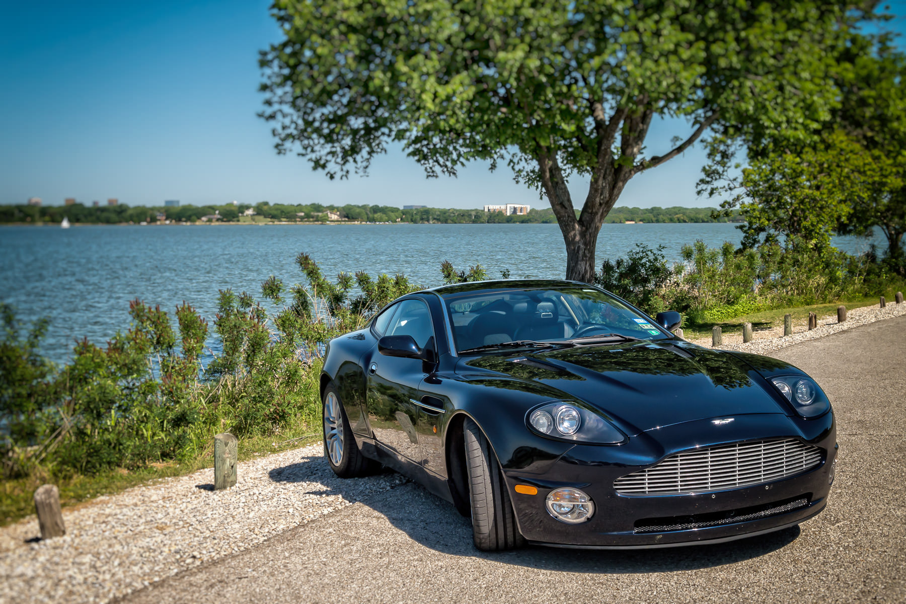 An Aston Martin parked on the shoreline of White Rock Lake, Dallas.