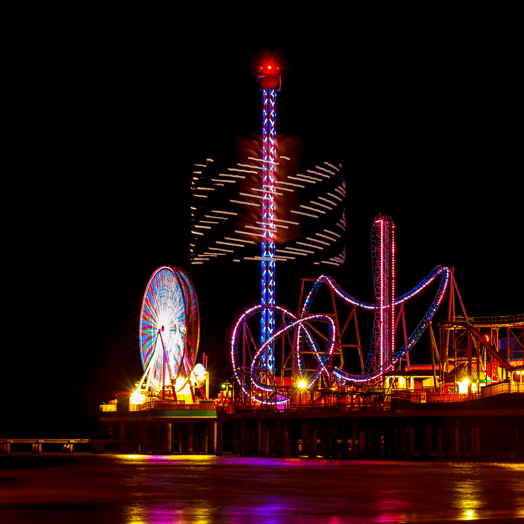 A long-exposure shot of Galveston, Texas' Pleasure Pier at night.
