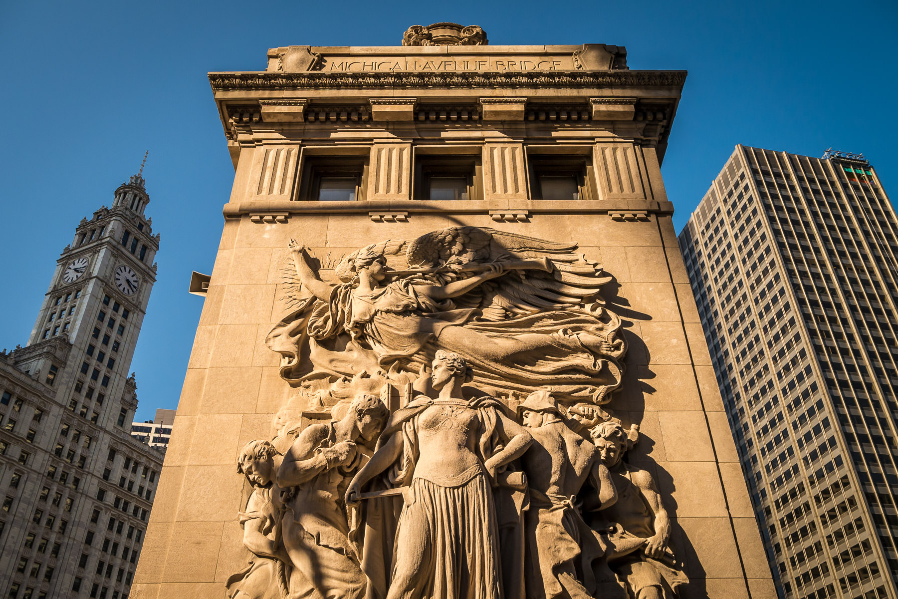 One of four sculptures by James Earle Fraser on the bridgehouses of Chicago's Michigan Avenue Bridge (or DuSable Bridge); this one is entitled Regeneration and depicts the reconstruction of the city after the Great Fire of 1871.