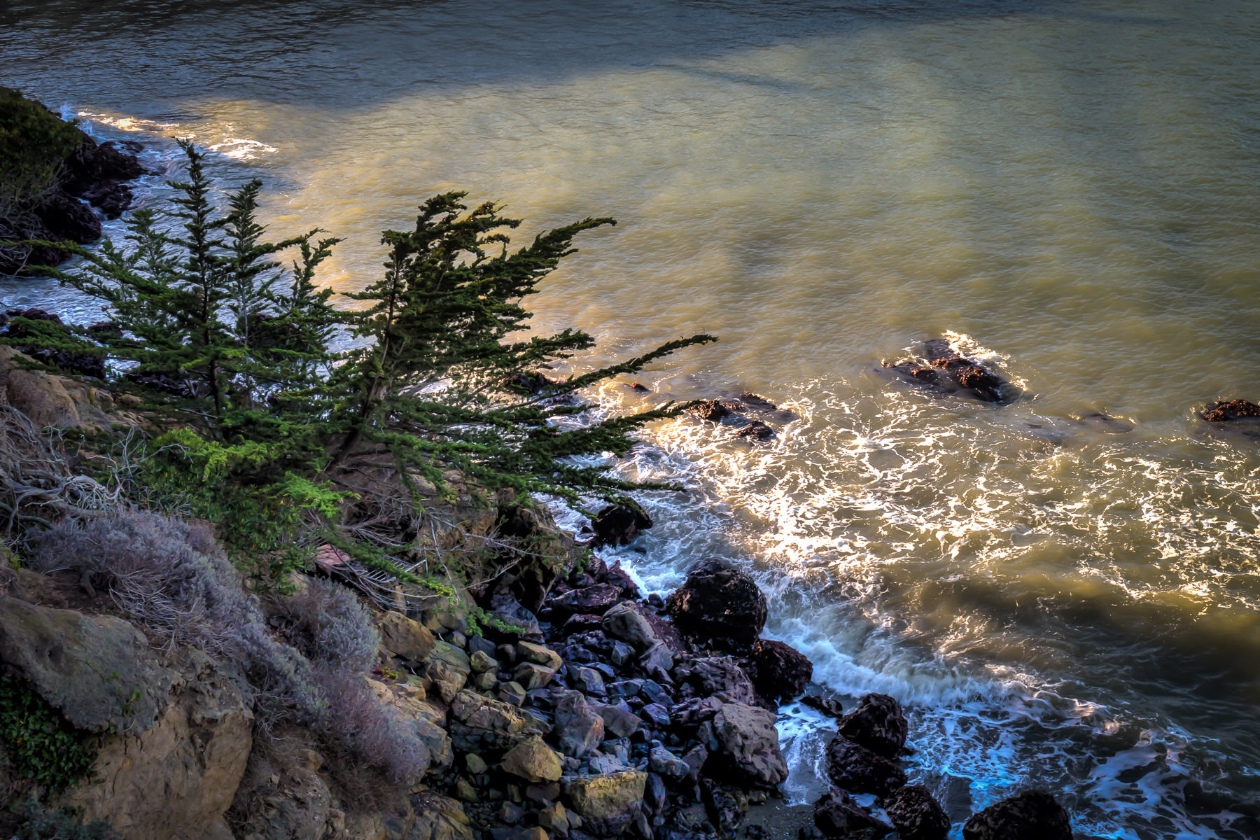 Waves in San Francisco Bay crash into the rocks at Black Point near Fort Mason National Park.