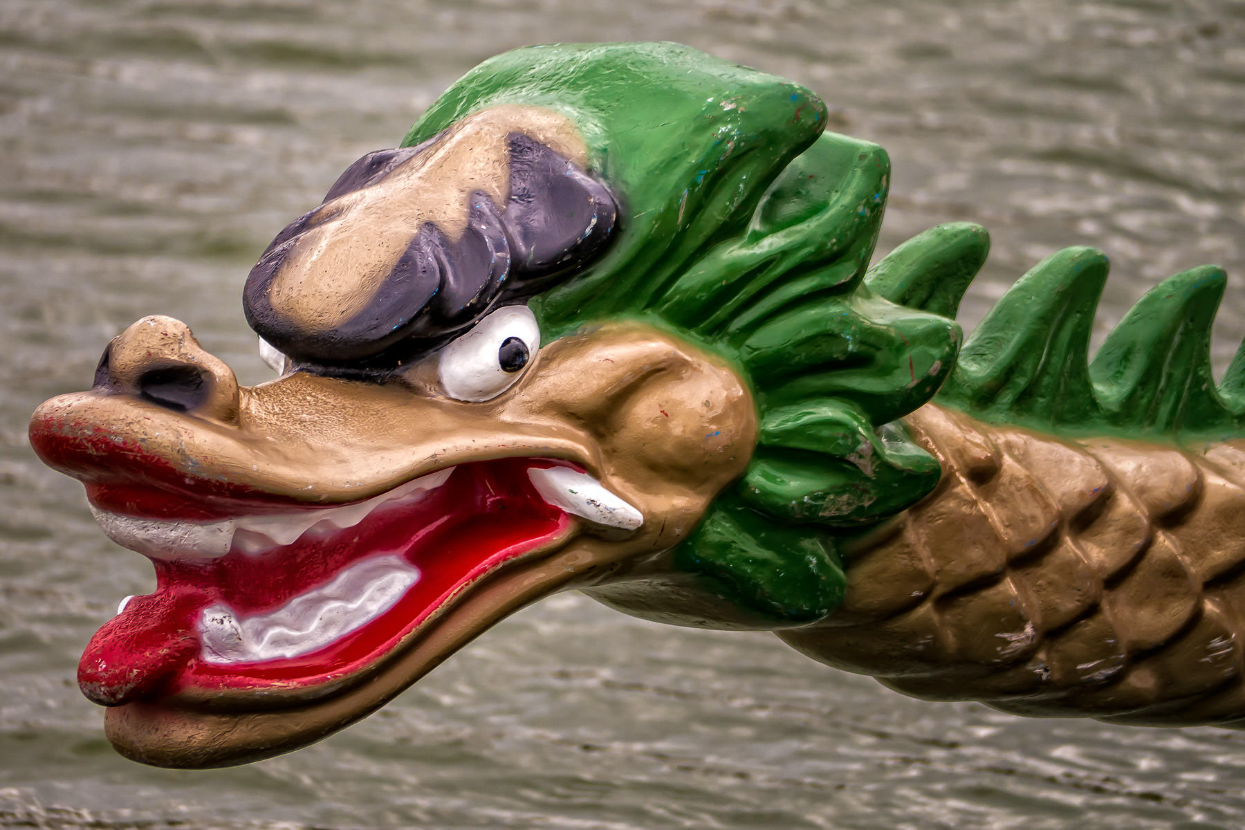 The figurehead on a dragon boat at the DFW Dragon Boat and Kite Festival, Las Colinas, Irving, Texas.