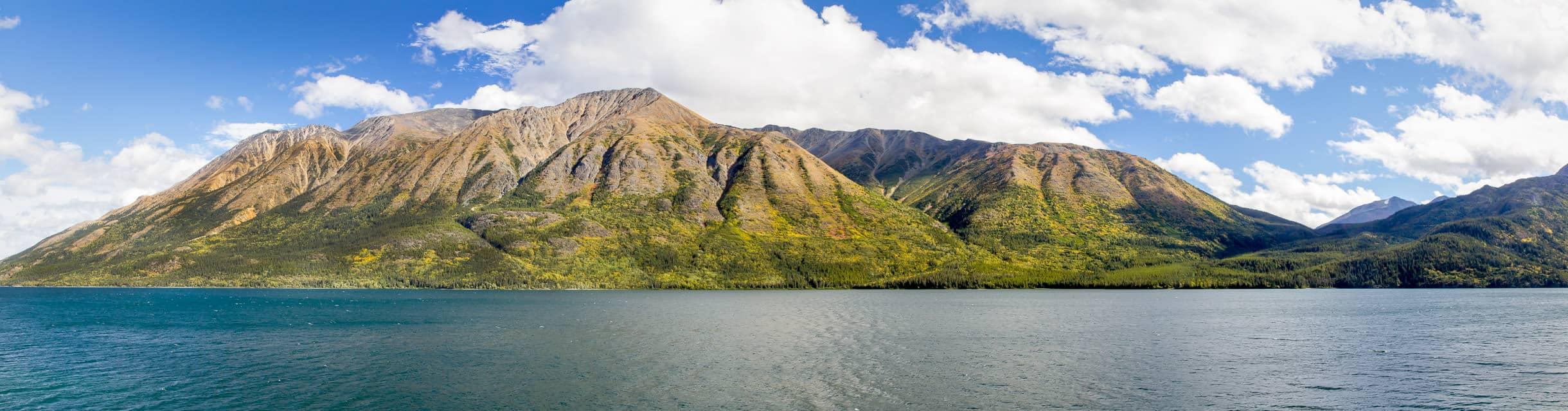 Mountains rise on the far shore of Tutshi Lake, British Columbia, Canada.