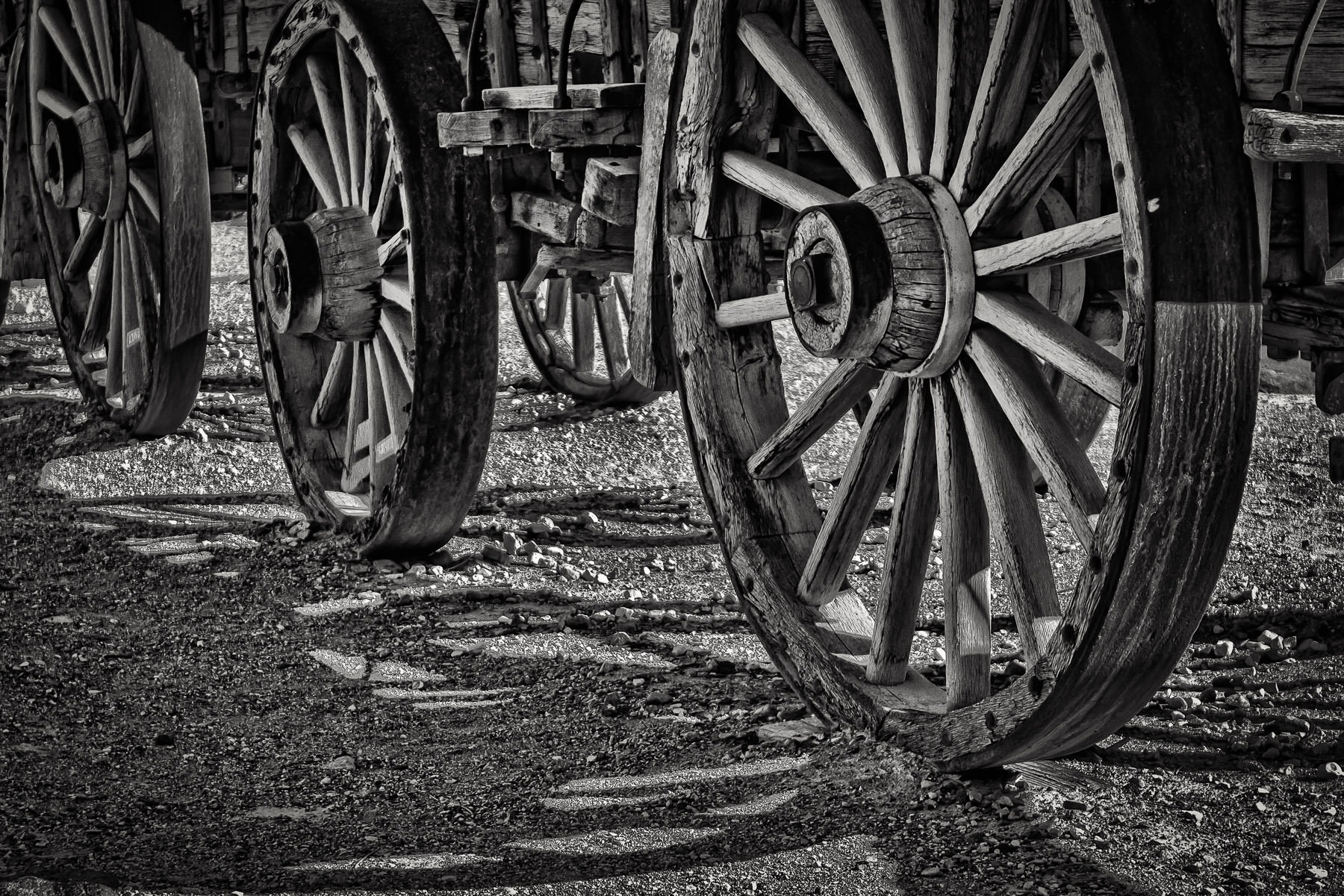 Wheels on old wagons for hauling borax on display in Death Valley National Park, California.