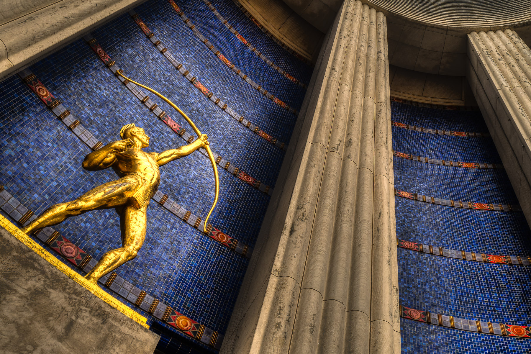 Sculptor Allie Victoria Tennant's The Tejas Warrior guards the entrance to the Hall of State at Fair Park, Dallas.