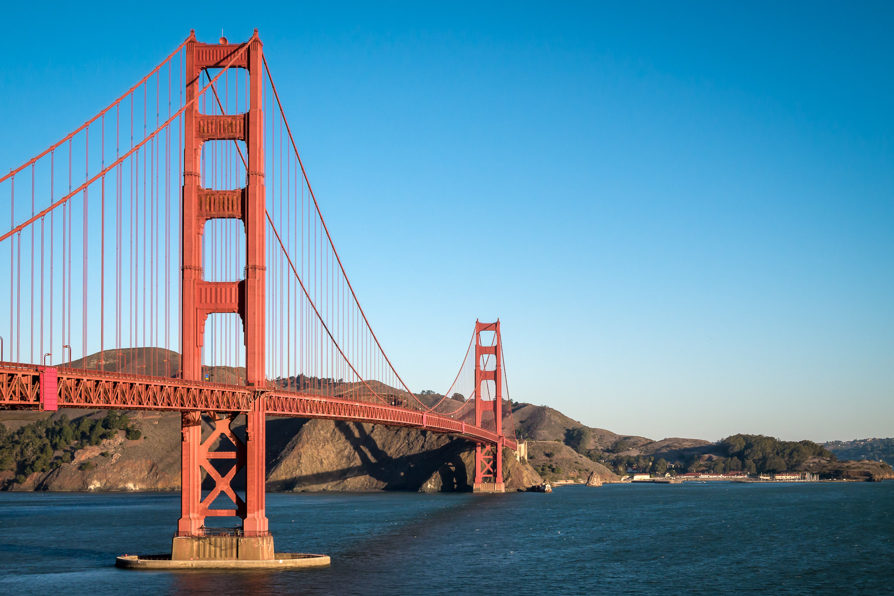 The iconic Golden Gate Bridge reaches for the Marin Headlands as it spans the entrance to San Francisco Bay.