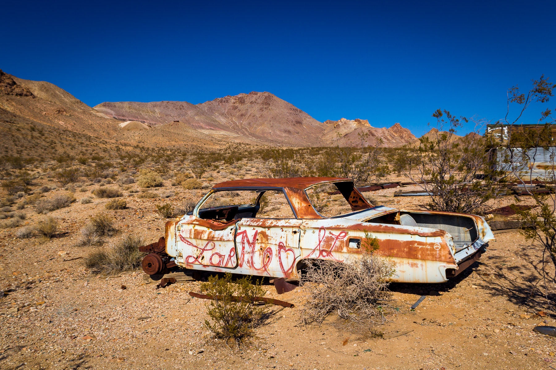 An old Chevrolet Impala rusts in the desert at the Nevada ghost town of Rhyolite.