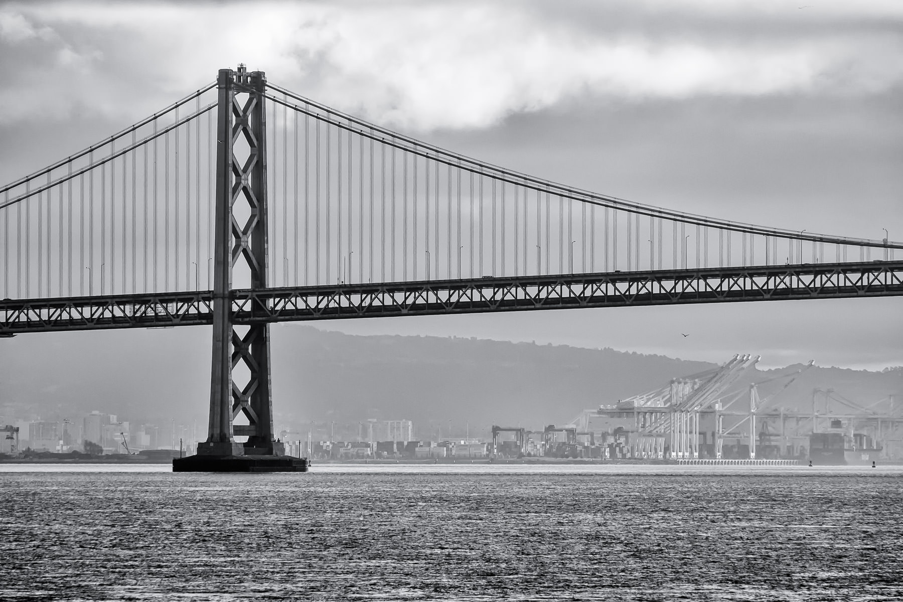 One of the towers of the San Francisco-Oakland Bay Bridge rises above San Francisco Bay.