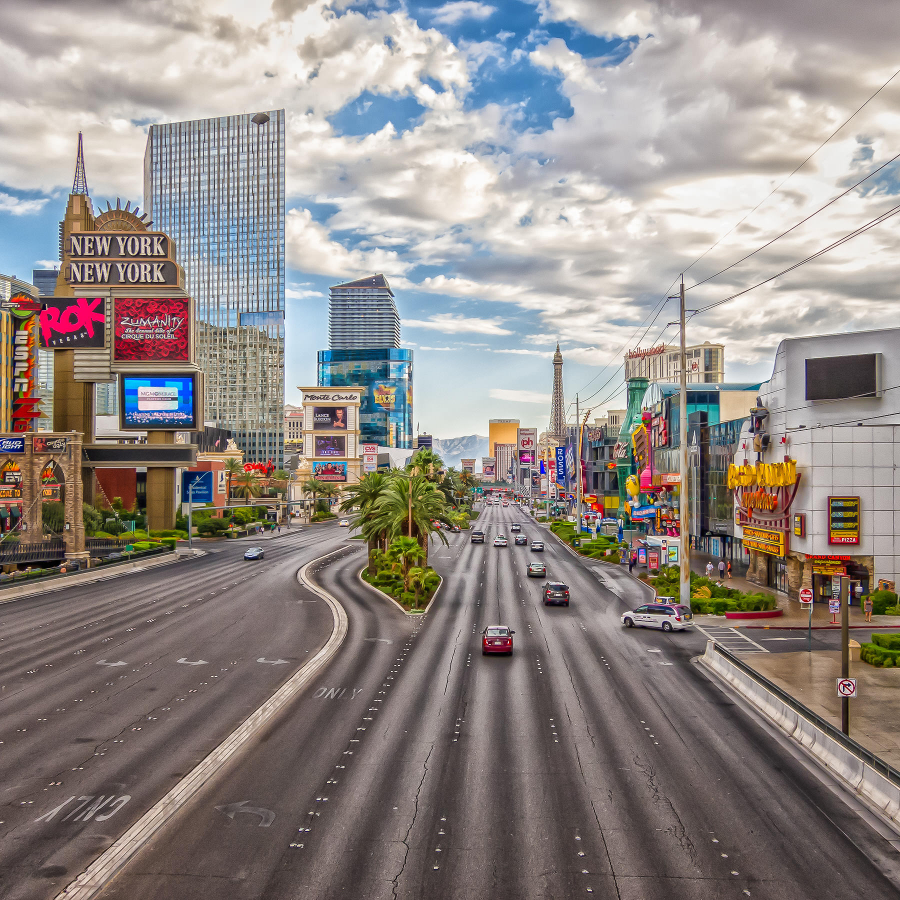The iconic Las Vegas Strip—also known as Las Vegas Boulevard—stretches northward as seen from a pedestrian bridge between New York New York Hotel & Casino and the MGM Grand.