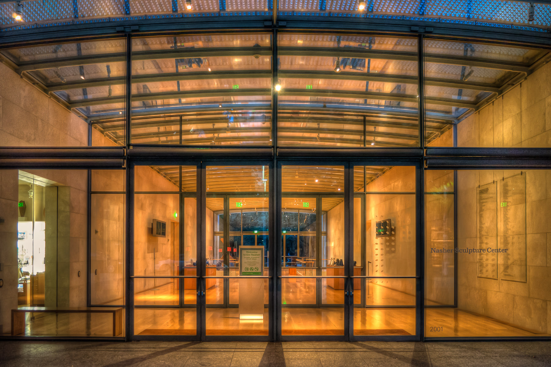 The entrance and lobby to Dallas' Nasher Sculpture Center, empty of patrons after closing time.