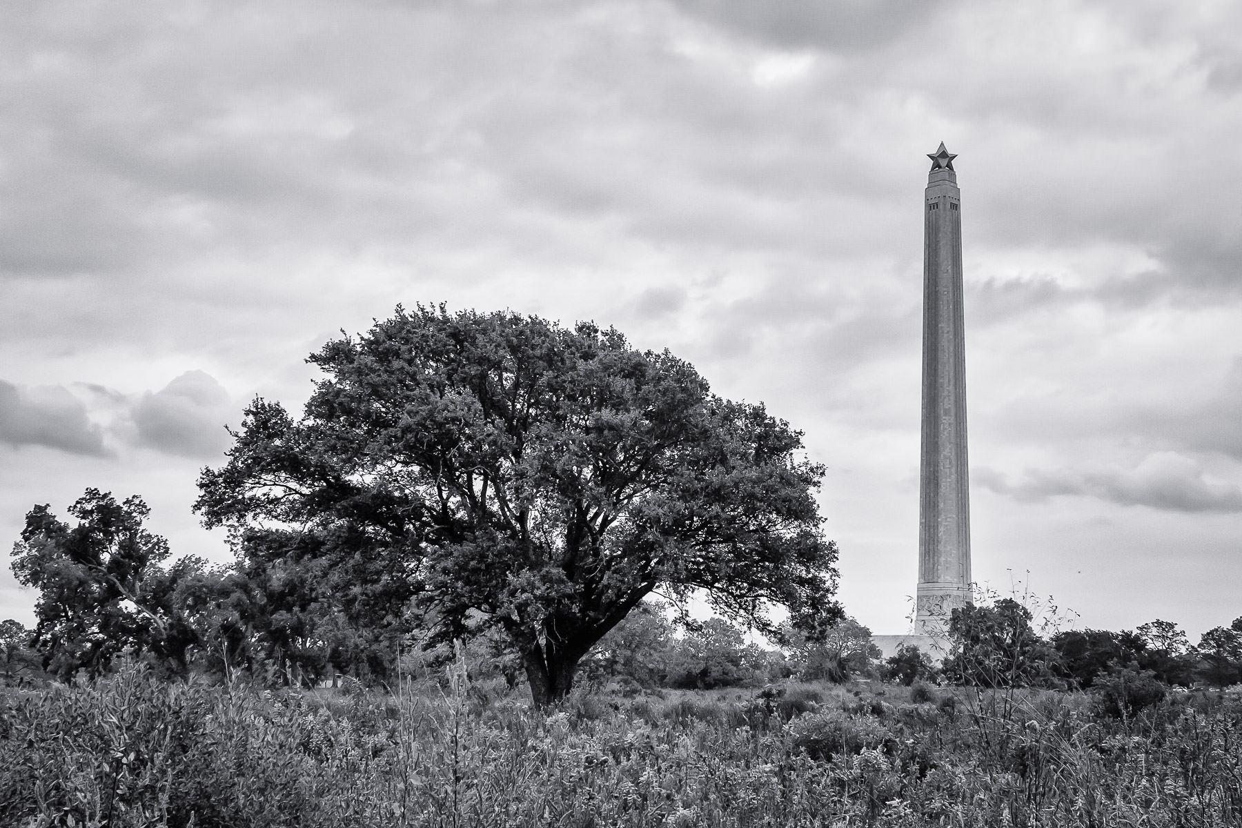 Texas' San Jacinto Monument—a 567-foot-tall granite column that commemorates the Battle of San Jacinto during the Texas Revolution—rises above the surrounding fields along the Houston Ship Channel.