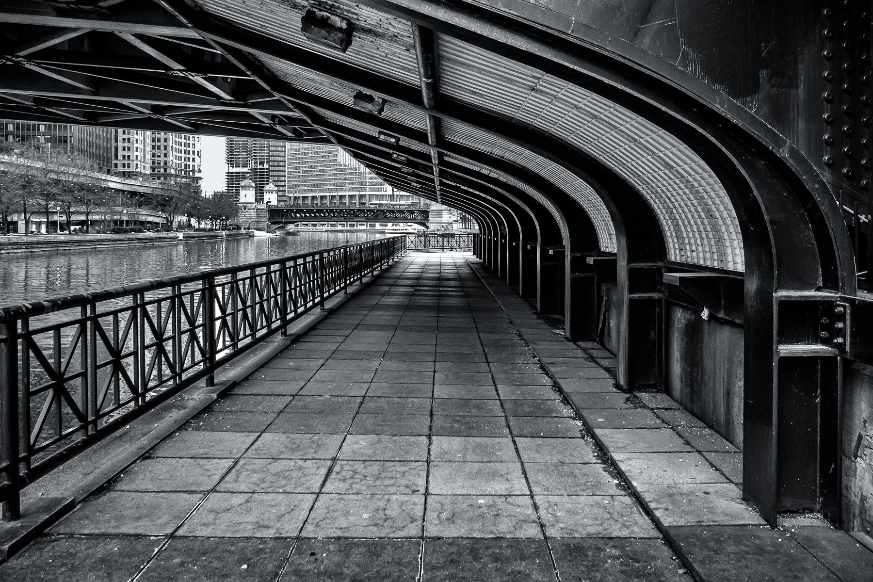 A view under the Columbus Drive Bridge westward in Downtown Chicago.