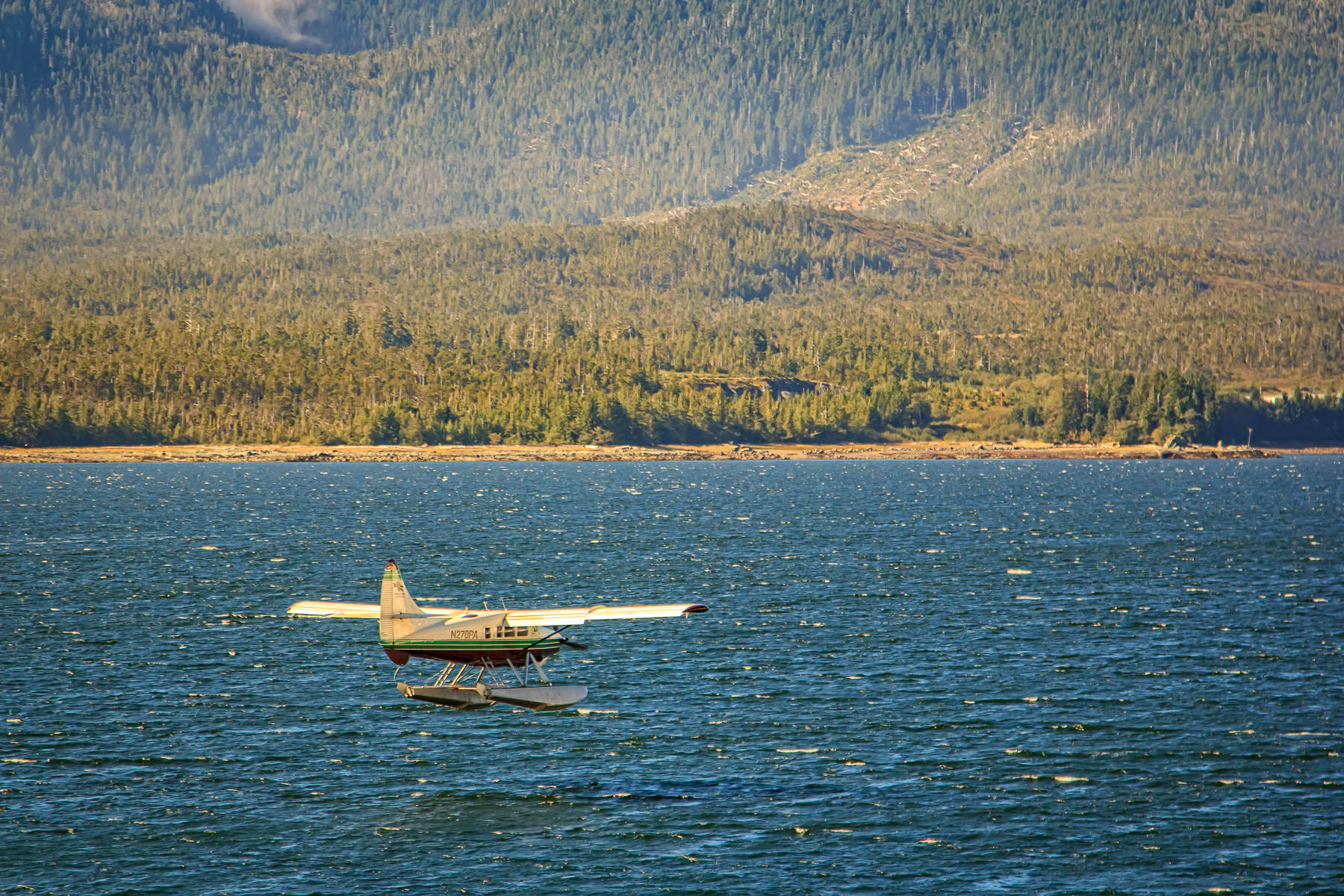 A floatplane lands in the Tongass Narrows in Ketchikan, Alaska.