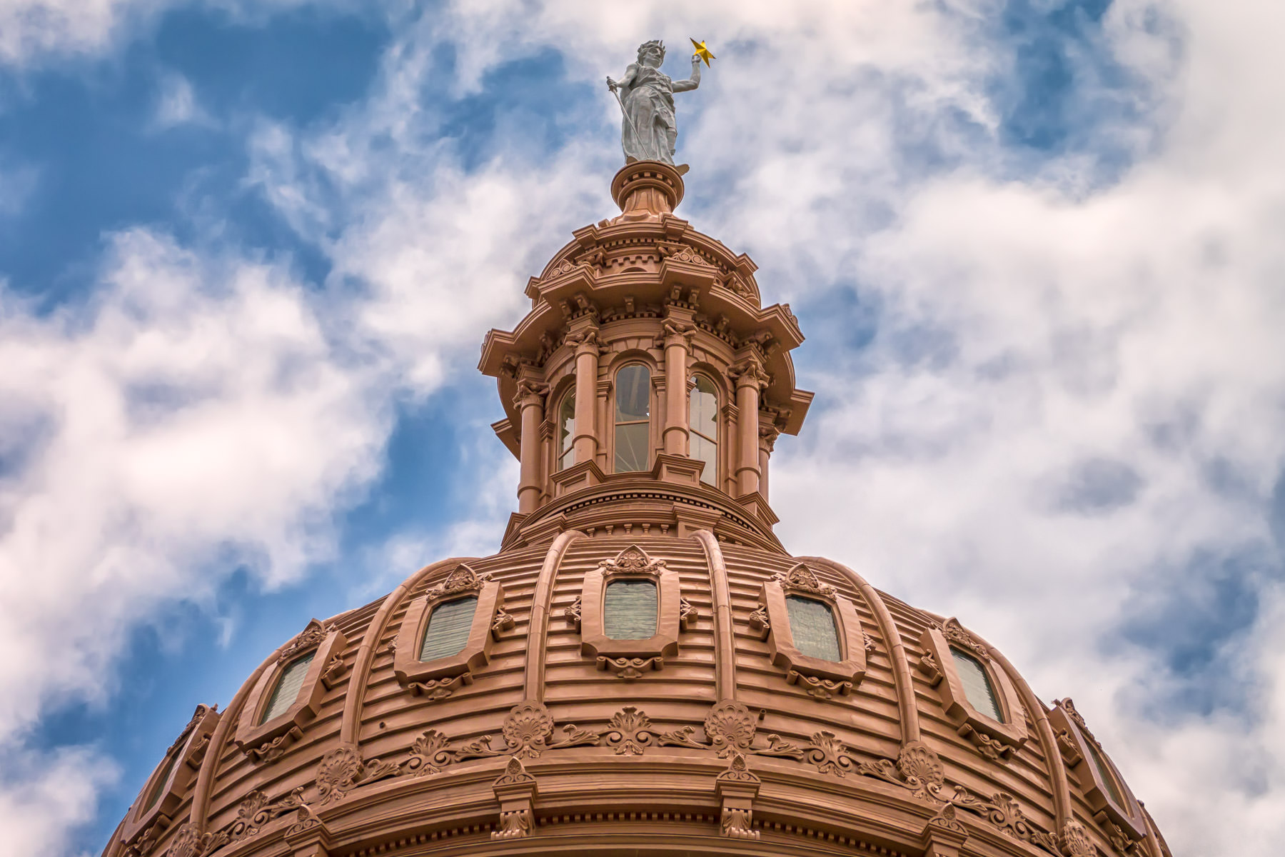 The Goddess of Liberty statue atop the 308-foot-tall dome of the Texas State Capitol, Austin.