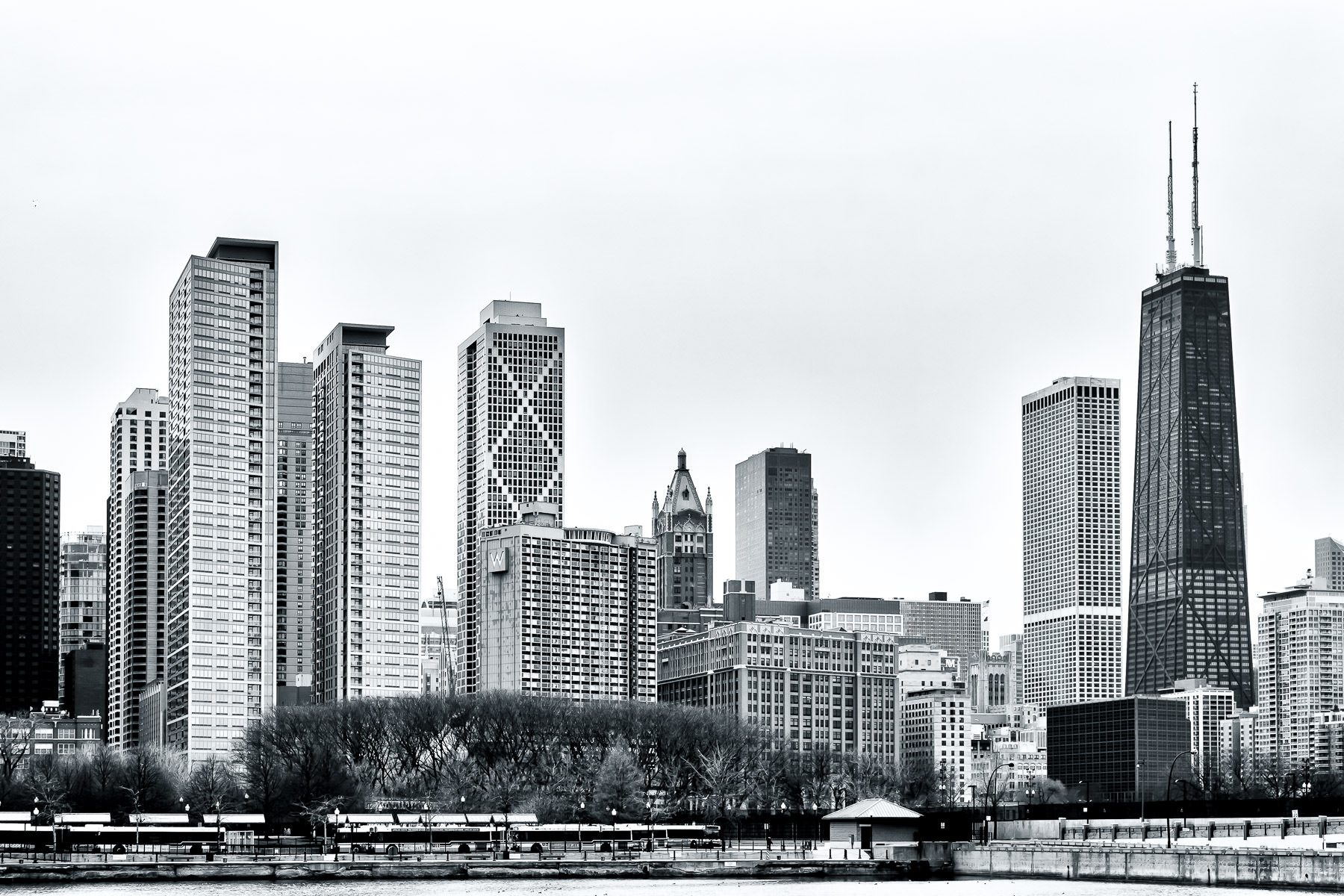 Chicago's 100-story-tall John Hancock Center rises over the city's Gold Coast and Streeterville neighborhoods on a cold, overcast winter day.