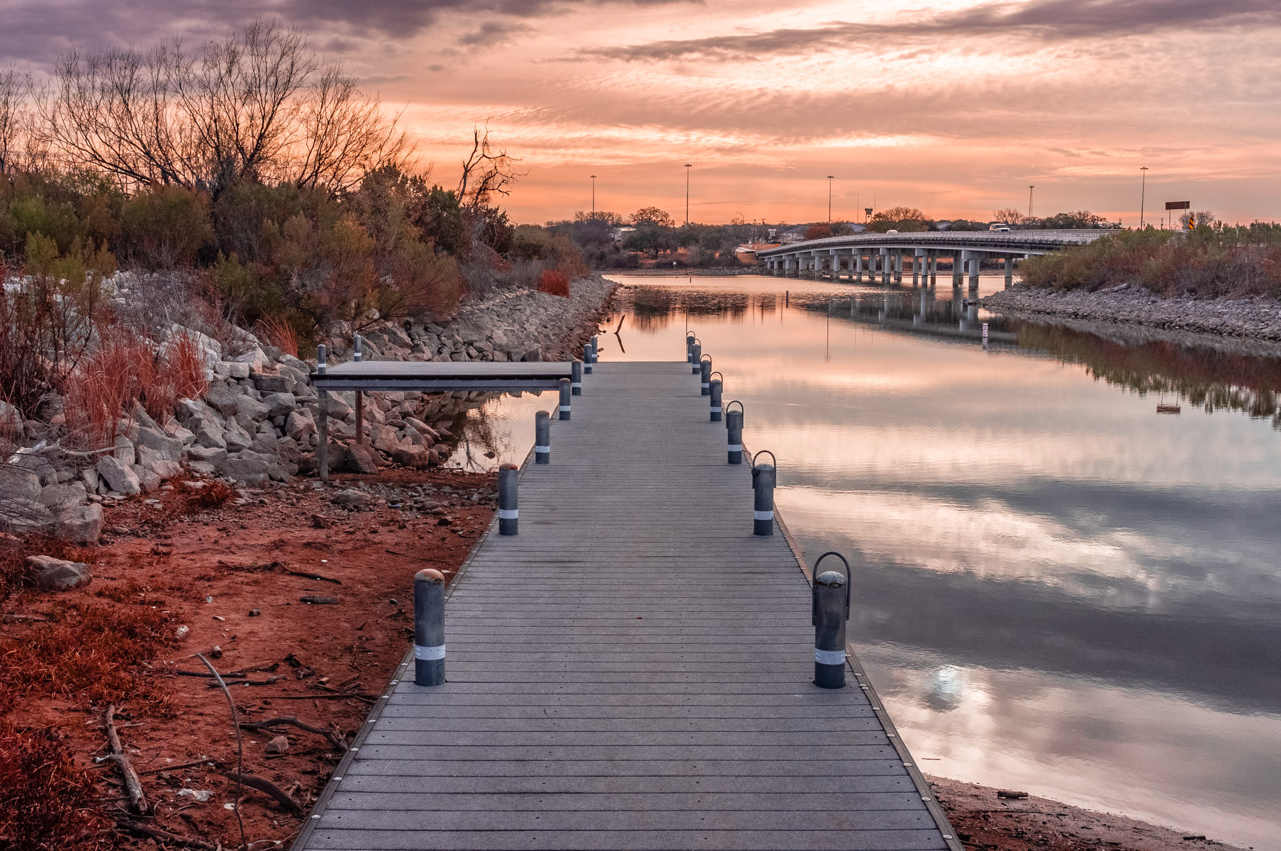 A pier—made almost useless by low water levels—greets the morning sun at Lake Granbury, Texas.