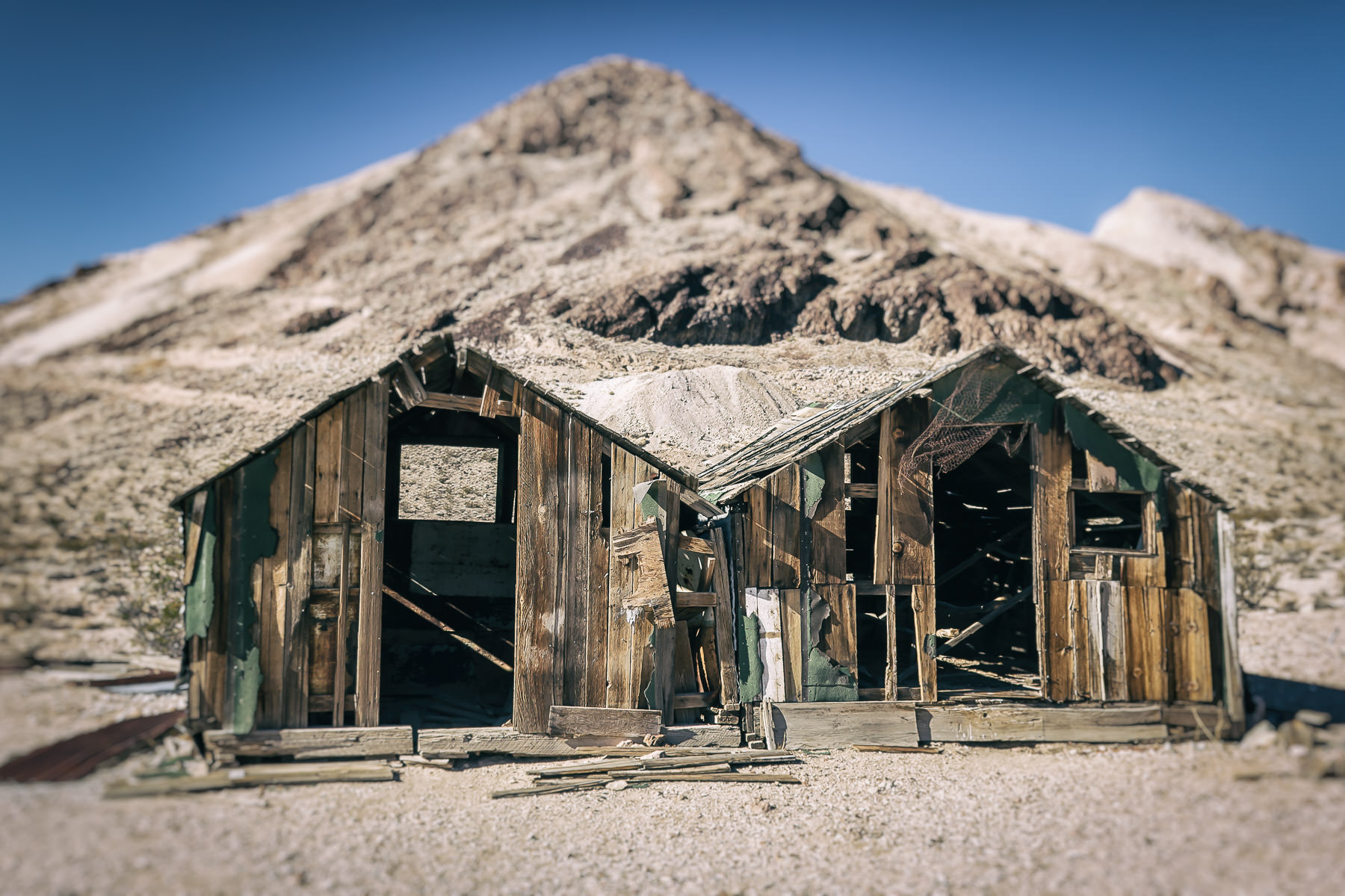 A pair of ancient shacks decay under the Nevada sun in the ghost town of Rhyolite.