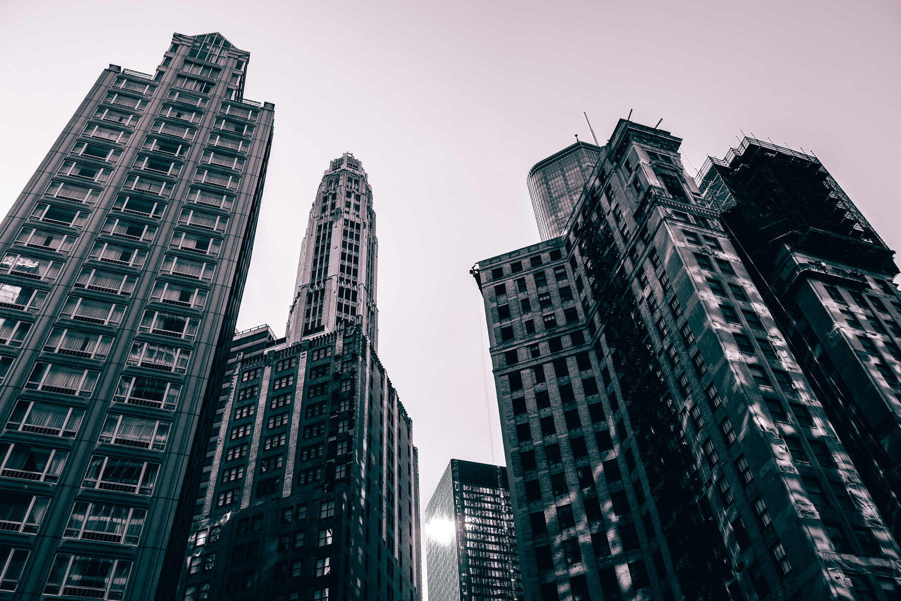 Old and modern skyscrapers rise into the sky over Chicago.