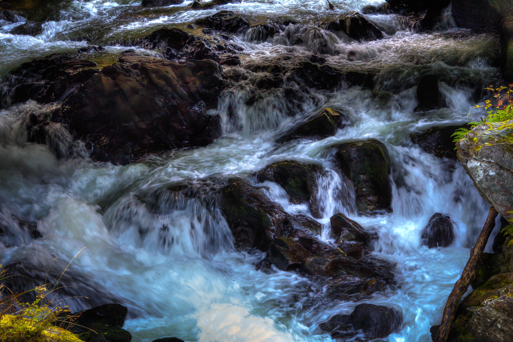 Water flows through a rock-strewn brook in Ketchikan, Alaska.