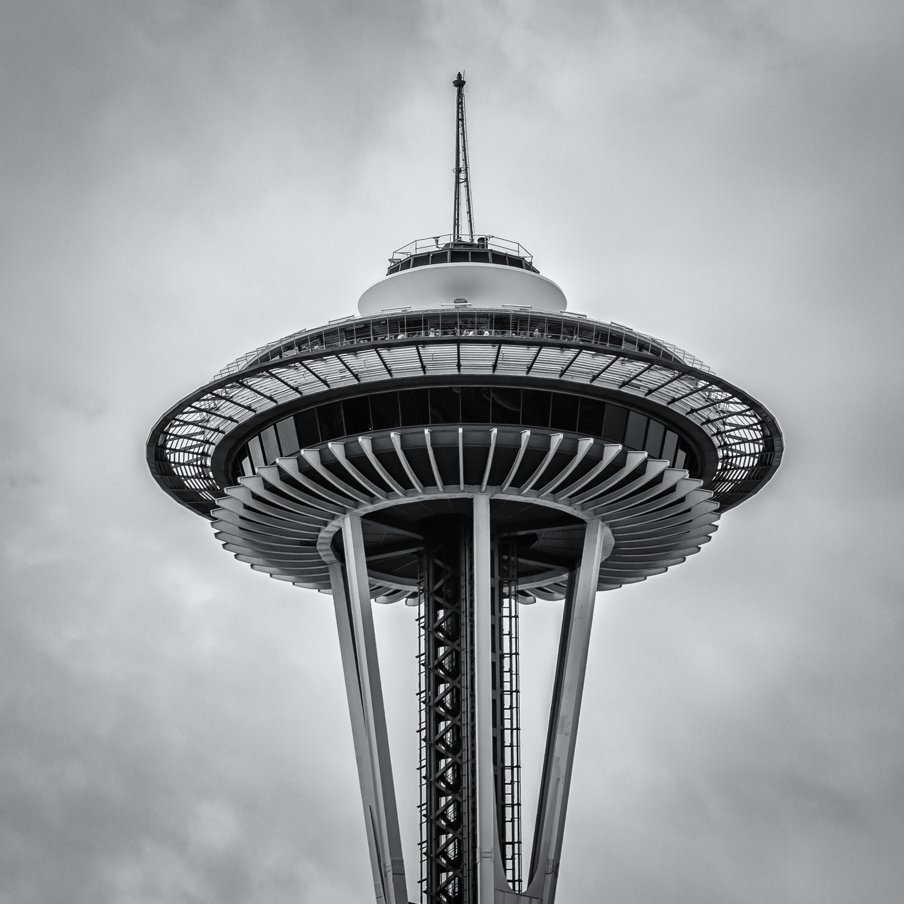 The Seattle Space Needle rises into the overcast Washington sky.