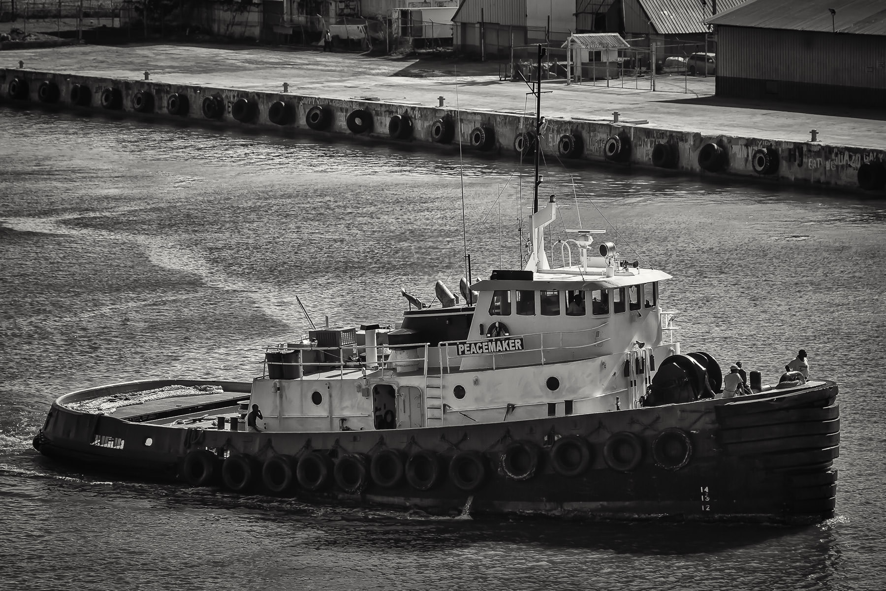 The tugboat Peacemaker plies the waters of Jamaica's Montego Bay.
