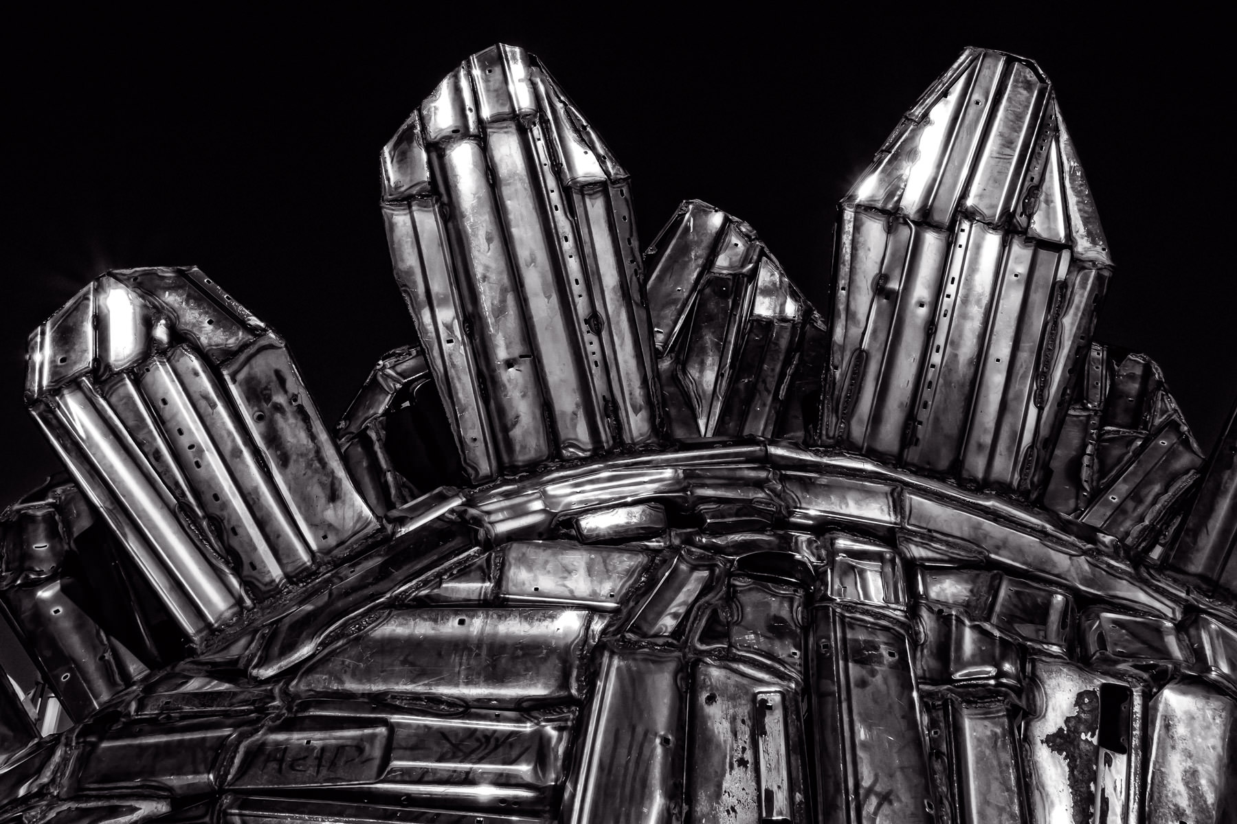 Detail of a sculpture of a chrome stegosaurus by artist John Kearney on display at Louis Tussaud's Palace of Wax in Grand Prairie, Texas.