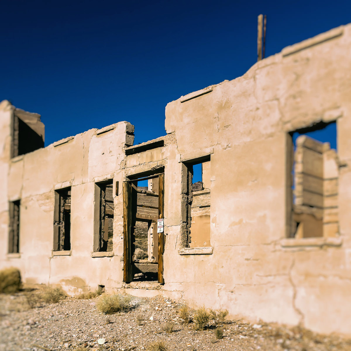 Deserted, crumbling ruins in the ghost town of Rhyolite, Nevada.