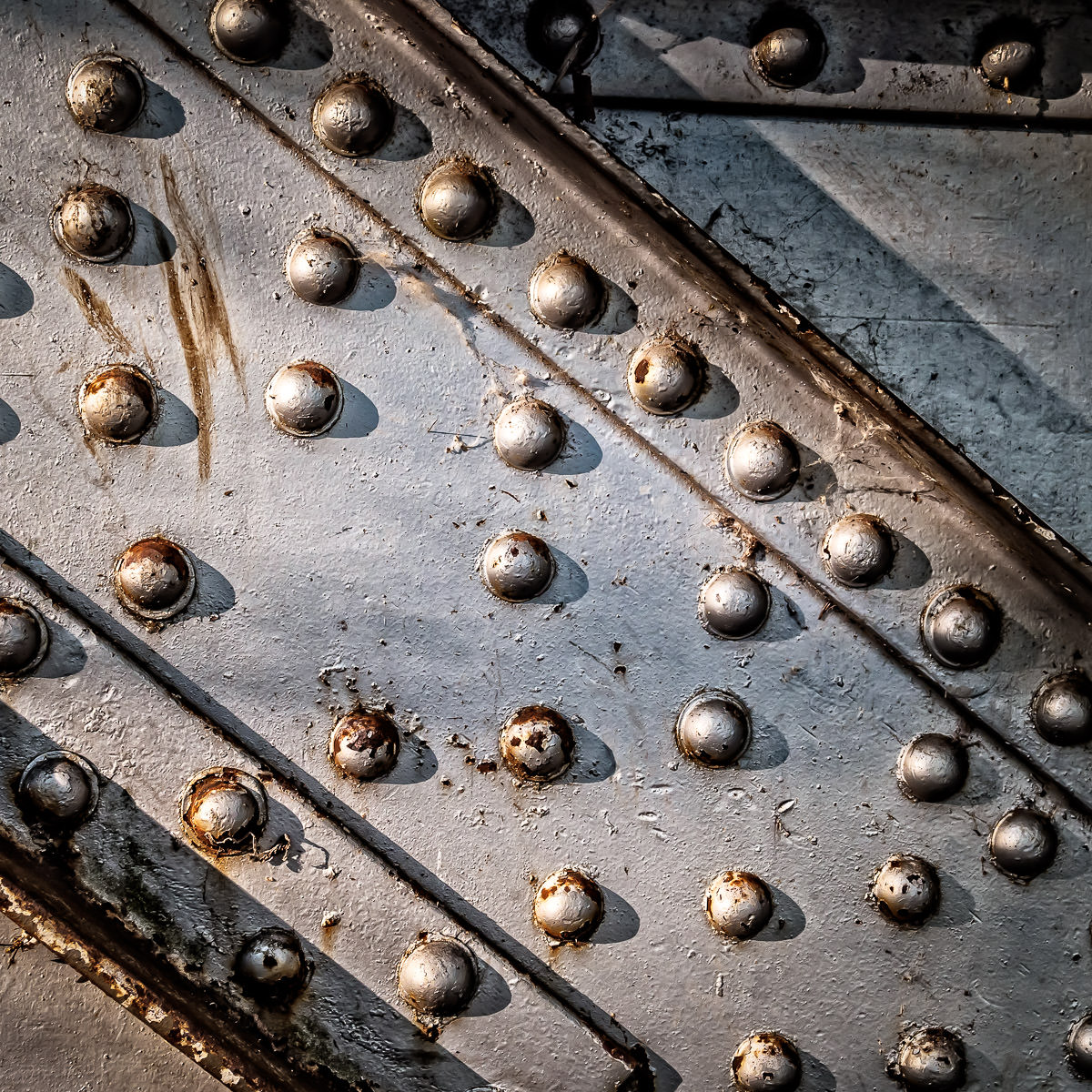 Detail of an abandoned iron railroad bridge in Waxahachie, Texas.
