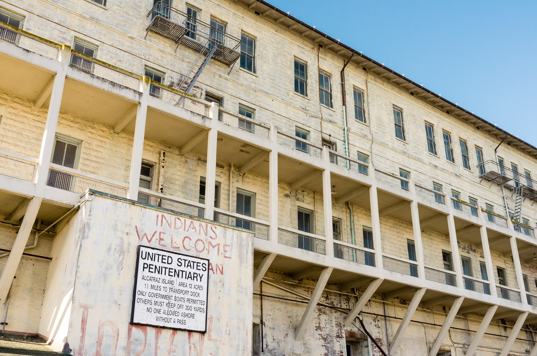 Alcatraz Penitentiary's Building 64, where fading graffiti—a relic of the nineteen-month (November 20, 1969, to June 11, 1971) occupation of the island by the Indians of All Tribes organization—welcomes modern-day visitors to the island.