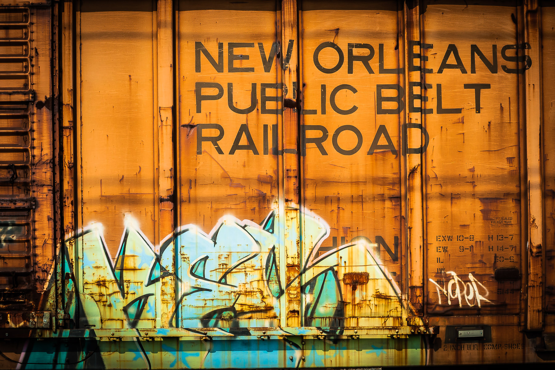 Graffiti on a New Orleans Public Belt Railroad boxcar, found on a rail siding in Farmers Branch, Texas.