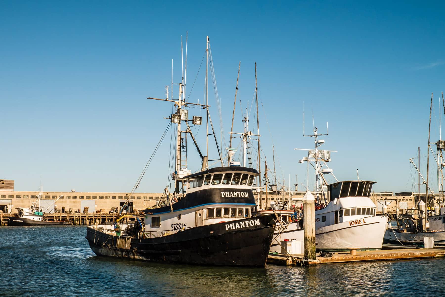 Boats docked at a pier along San Francisco's Fisherman's Wharf.