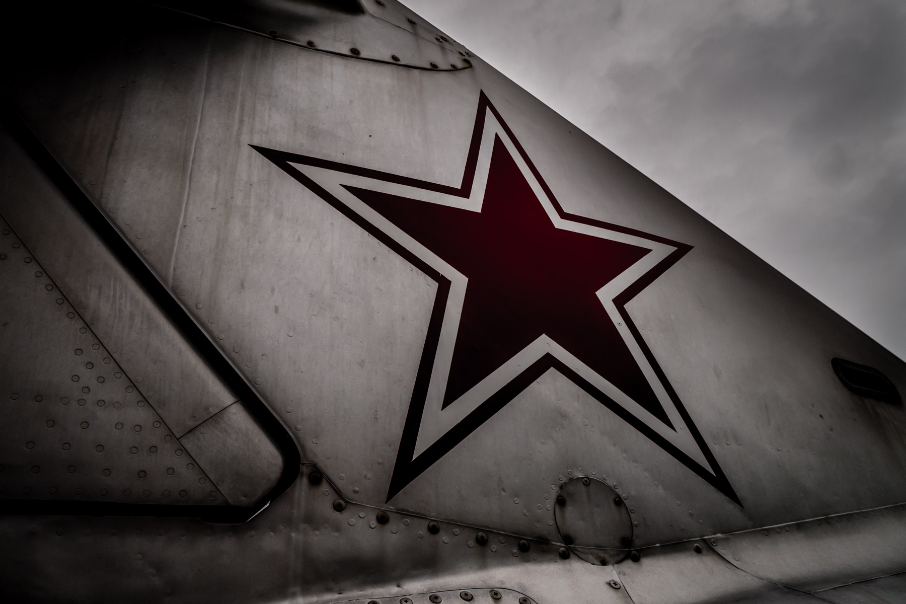 A Soviet-style red star on the tail of a former Polish Air Force MiG-17F in the collection of the Cavanaugh Flight Museum, Addison, Texas.